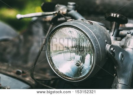 Close View Of Headlight Of The Old Rarity Gray Tricar Or Three-Wheeled Motorbike With A Sidecar.