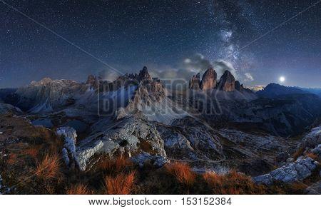 Alps Mountain landscape with night sky and Mliky way Tre Cime di Lavaredo Dolomites