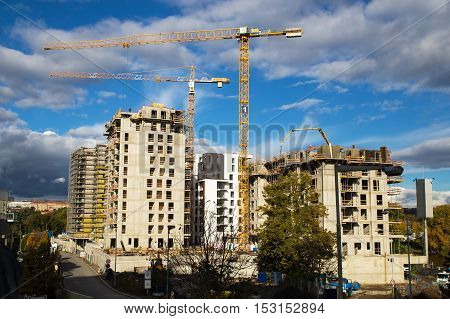 construction offices with big derricks and blue sky