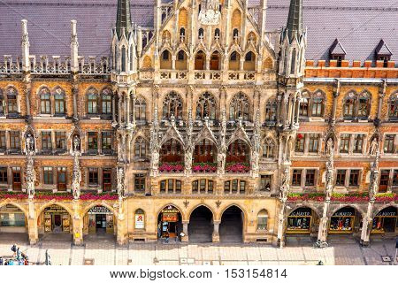 Munich, Germany - July 03, 2016: Top view on the town hall's facade on Mary's square in Munich. This building hosts the city government including the city council, mayors and administration