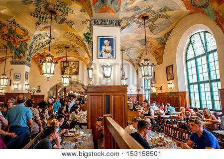 Munich, Germany - July 03, 2016: Crowded interior of famous Hofbrauhaus pub in Munich. Hofbrauhaus is a biggest brewery and beer pub owned by the Bavarian state government.