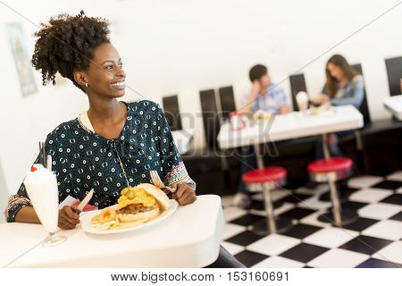African American Woman In Diner