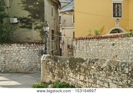 Senj Croatia: a small town in northern Croatia located on the Adriatic coast. Trg Cimiter historic buildings of the old town. poster