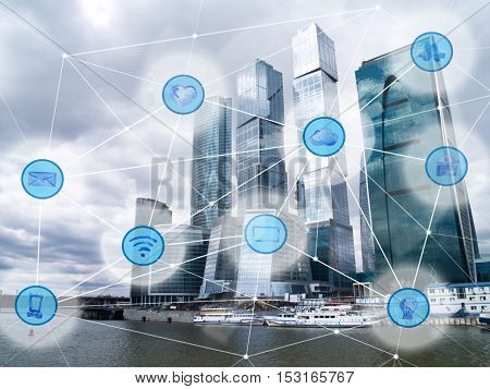 modern city with skyscrapers and wireless communication network, IoT Internet of Things and ICT Information Communication Technology concept poster