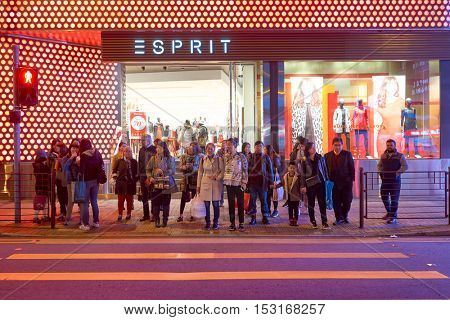 HONG KONG - CIRCA JANUARY, 2016: people waiting to cross the street in Hong Kong. Hong Kong is an autonomous territory on the southern coast of China at the Pearl River Estuary and the South China Sea