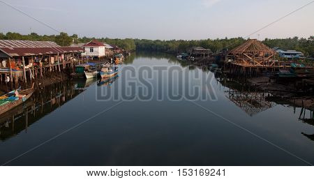 View of a River with houses and houses under construction. Indonesia