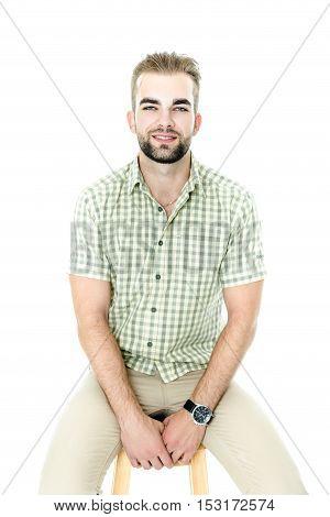 Handsome bearded man wearing shirt, portrait shot in studio