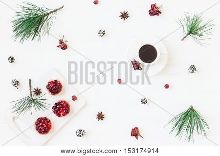 Christmas composition. Cup of coffee christmas dessert anise star pine branches. Flat lay top view