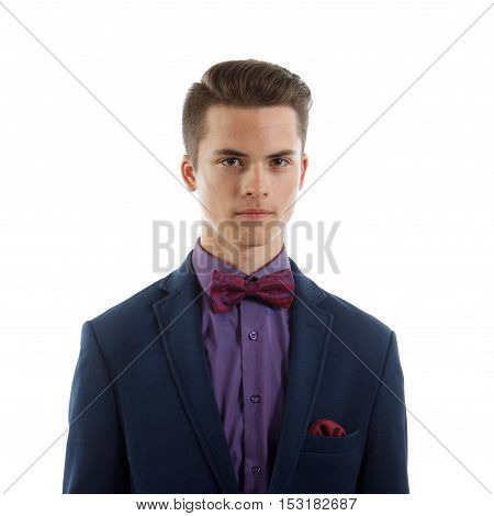 An elegant teenage boy wearing a suit