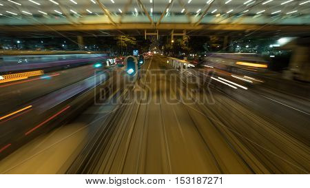 View to the road and transport from moving double-decker train. Shot in motion, Hong Kong