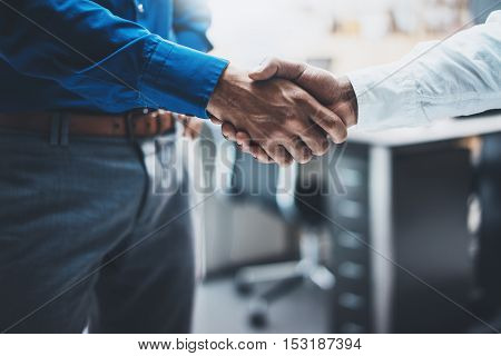 Business partnership handshake concept.Image of two businessmans handshaking process.Successful deal after great meeting.Horizontal, blurred background