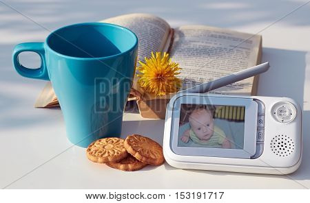 The close-up baby monitor for security of the baby on the table