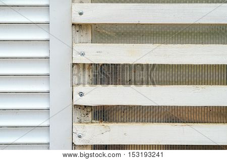 White Wall With Wooden Blinds With Horizontal Bars