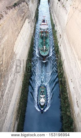 Tug conducting ship through the Corinth canal. Peloponnese. Greece