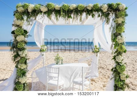 Beautiful wedding arch on the beach. In summer.