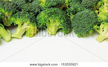 Macro closeup of green vegetables: cut broccoli. Broccoli texture closeup for any ideas. Fresh vegetables concept.