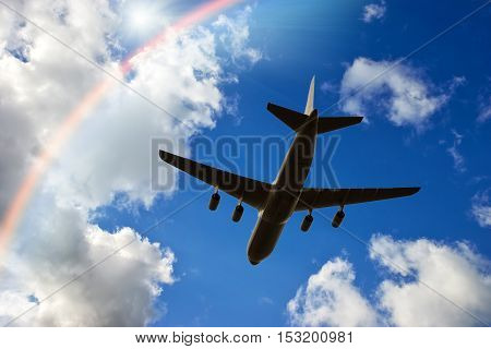 Airplane in cloudy deep blue sky. Airplane travel composition.