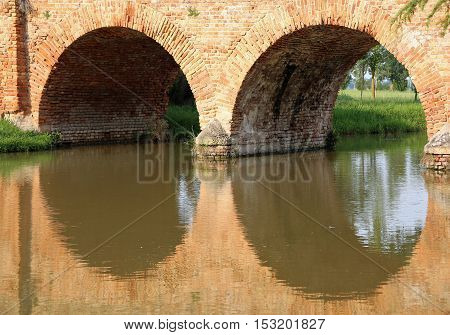 Old Bridge Made Of Red Brick With Arches