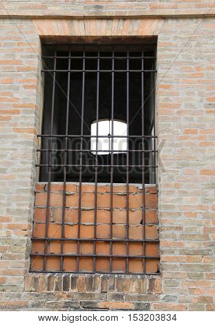 Broken Window Of An Abandoned House With Iron Bars And Broken Gl