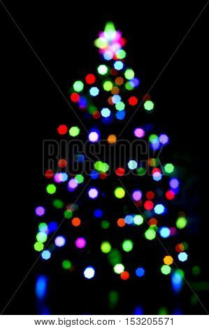 glowing christmas tree on dark background