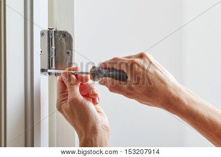 Door hinge installation.