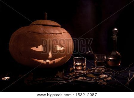 Funny Halloween pumpkins drinking wine at black background