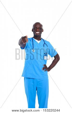 Handsome young doctor pointing finger at you isolated on white background