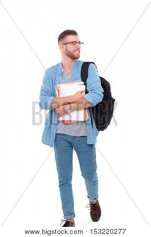 Young male student with school bag holding books isolated on white background