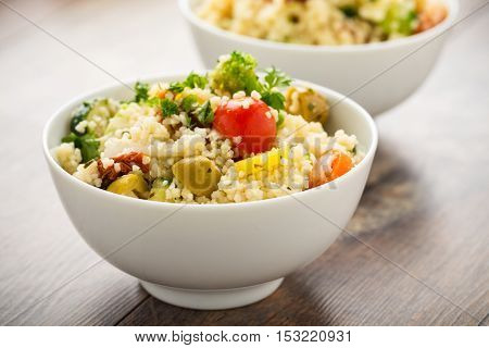Fresh cous cous with grilled vegetables and sun dried tomatoes.