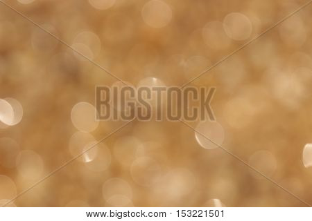 abstract blurred gold bokeh background from nature