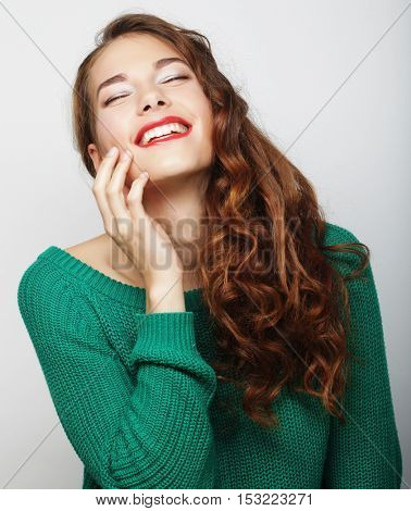 pretty young blond woman with curly hair