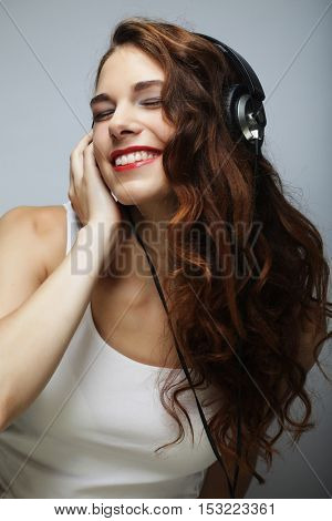 Young   woman with headphones listening music