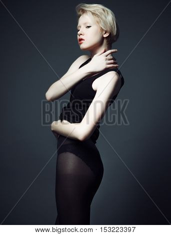 Fashion model with short blond hair