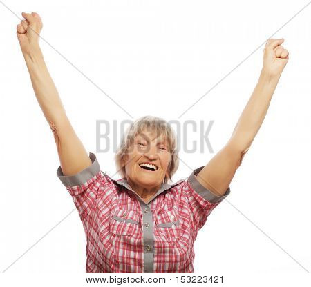 cheerful senior woman gesturing victory over a white background