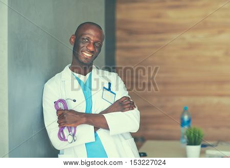Doctor with arms folded in modern office