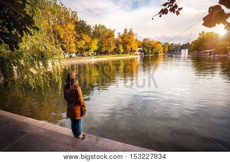 Woman Near The Lake At Autumn Park