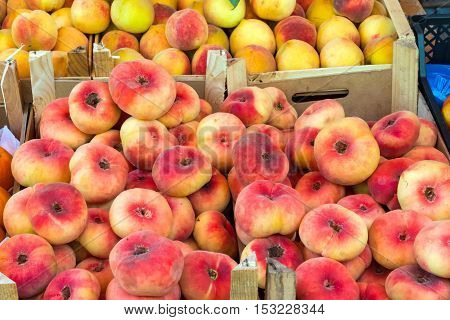 Different kinds of peaches for sale at a market in Palermo