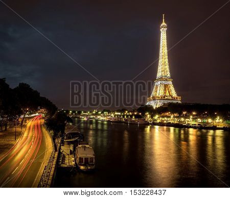 PARIS - AUGUST 04: Lighting the Eiffel Tower on August 04, 2016 in Paris. Eluminate Eiffel tower is the most popular travel place and global cultural icon of the France and the world.