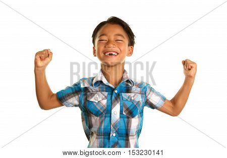 Cute Filipino Boy on a White Background with his arms and fists up and a big smile.  You can see that his two front teeth are missing.
