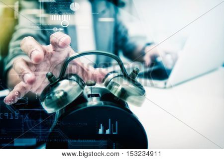 Business People Write Something About Meeting Subject On Laptop Computer Hand Holding The Clock ,bus