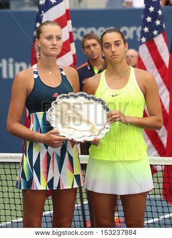 NEW YORK - SEPTEMBER 11, 2016: US Open 2016 women doubles runners up Kristina Mladenovic (L) and  Caroline Garcia of France during trophy presentation at the Billie Jean King National Tennis Center