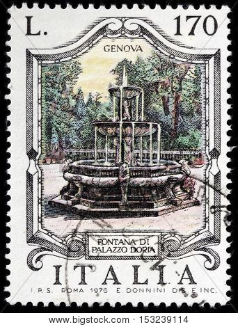 LUGA RUSSIA - JUNE 25 2016: A stamp printed by ITALY shows view of the famous Palace Doria fountain (Fontana di Palazzo Doria) in Genoa Italy circa 1976