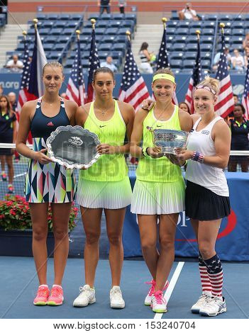 NEW YORK - SEPTEMBER 11, 2016: Caroline Garcia(L), Kristina Mladenovic (France), Lucie Safarova (Czech) and B. Mattek-Sands of USA during trophy presentation after US Open 2016 women doubles fina