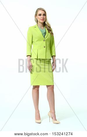 woman with straight hair style in light green skirt power suit high heels shoes full length body portrait standing isolated on white