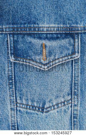 closeup detail of a vintage denim jacket. Top view.