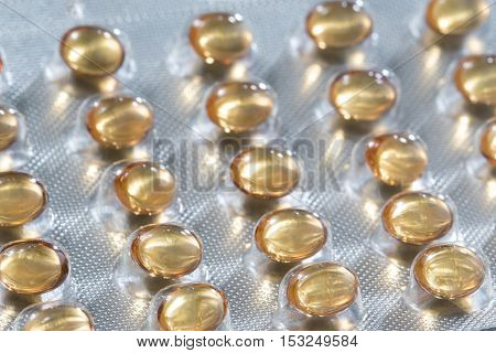 Closeup of Set Vitamin D pills with fish oil