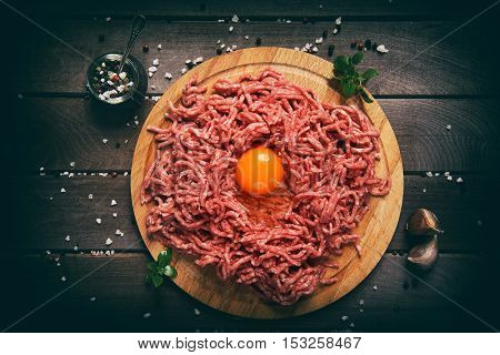 Chopped Red Meat On A Wooden Background.