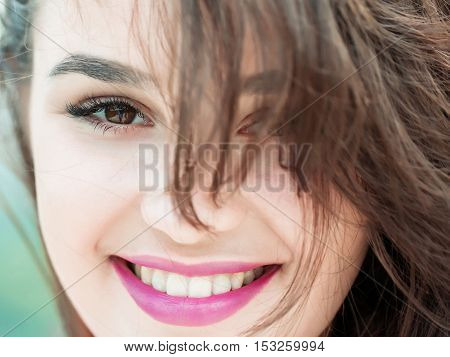 Young woman brunette with pretty cute smiling face hazel eyes fashion natural makeup pink lips and perfect healthy skin