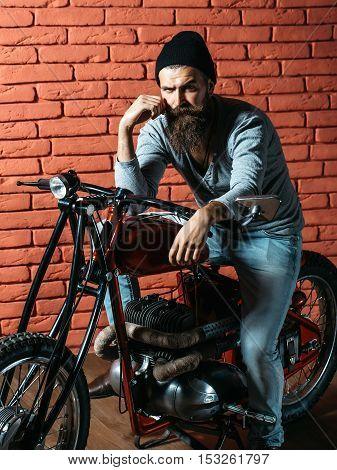 Bearded Biker Man On Motorbike