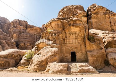 A carved facade of a Nabatean temple situated at the entrance of the Siq Al Barid Little Petra